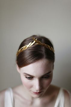 A gold, textured headband for a wedding or summer party
