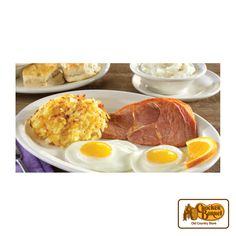 Start your day with Uncle Herschel's Favorite(R). Two eggs, grits, Sawmill Gravy and biscuits. Served with Fried Apples or Hashbrown Casserole and your choice of Country Ham, Grilled Pork Chop, Sugar Cured Ham or Fried Chicken Tenderloin.    Answer fun questions and you could win in the Cracker Barrel Old Country Store Pick it to Win it Sweepstakes. Start 'picking' your answers at crackerbarrel.com/win (ends Jan 2, 2013).