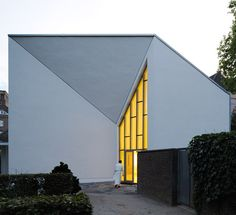 German architects Astoc have completed a monastery extension in Duisberg with walls that fold around the entrance like origami sculptures..