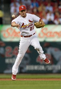 ST. LOUIS, MO - APRIL 17: David Freese #23 of the St. Louis Cardinals throws on the run against the Cincinnati Reds at Busch Stadium on April 17, 2012 in St. Louis, Missouri. (Photo by Jeff Curry/Getty Images)