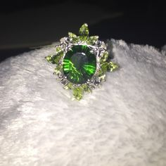 Helenite Hebei Peridot Diamond Ring. Heleniite (oval 3.75 Ct), Hebei Peridot and Diamond Ring (size 8). Platinum overlay sterling silver nickel free. TDW .02 carats. TGW 5.65 carats!  This ring is amazingly beautiful!!!! Jewelry Rings
