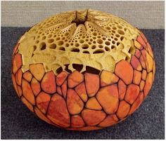 """Fire Bowl"" 8"" in diameter. Carving by Mark Doolittle; paper applique by Kathy Doolittle"