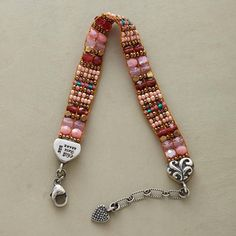"""ROSE OF THE WEST BRACELET--Artist Adonnah Langer looms a rosyhued bracelet of Czech and Japanese seed beads and tips it with handstamped sterling silver. Sterling clasp. USA. Exclusive. 6-1/2"""" to 7-3/4""""W."""