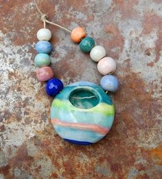 Handmade ceramic flower vase pendant. Would be lovely with a few drops of essential oils as well. The original! Gaea Ceramic Bead and Art Studio Blog / gaea.cc