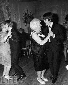 Harrison and Starr dance with their mothers at the premiere party for the film A Hard Day's Night in London, 1964.