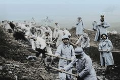WWI, 1916, Verdun; In the open quarries, territorial French soldiers dig up the rock that will reinforce the road from Verdun to Bar-le-Duc Train. Picture; Nat Geographic