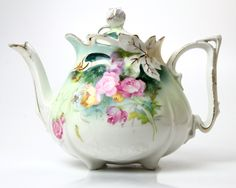 Absolutely exquisite! Antique porcelain teapot with roses in pink and yellow. This stunning teapot will be the centerpiece of your next tea party