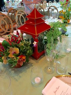 Gorgeous metal hand painted pagoda center of Asian theme table scape maiden hair ferns orchids and climates