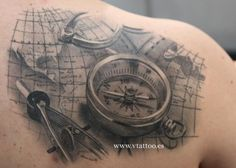 Compass and map tattoo.