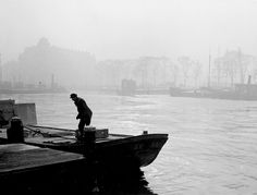 """1949. View on the river Het IJ in Amsterdam. The river Het IJ or Binnen-IJ separates the center of Amsterdam from the northern part of the city (Amsterdam-Noord) and was originally a bay of the Zuiderzee. The name IJ is related to the (West) Frisian Ae, Ee or Die which means """"water"""". Photo Kees Scherer. #amsterdam #1949 #HetIJ"""