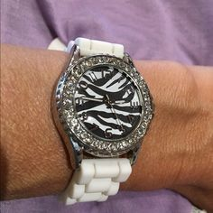 "Zebra faced bling watch   Listing!!  Watch band is rubber, all bing intact! Zebra face, no brand name. Face including protected stem is almost 1-1/2"". Needs new battery.  Accessories Watches"