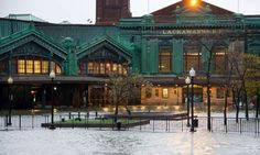 The Hudson river rises over its banks flooding the Lackawanna train station as Hurricane Sandy approaches, in Hoboken, New Jersey on Monday (29 Oct 2012)