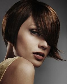 A medium brown straight coloured long bob hairstyle by Angels Hairdressing