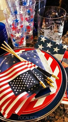 Serving up patriotic place-settings with a mix of thrift (the Eagle etched glass cylinder) and melamine stripe plates plus blue metal chargers from HomeGoods and stars + stripes bandanas as napkins! Happy 4th of July! #HomeGoodsHappy #HappyByDesign #sponsored