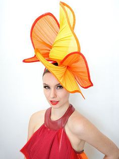Colourful fans at the Melbourne Cup Racegoer Bianca Nicholson poese for a photo on Melbourne Cup Day at Flemington Racecourse in Melbourne