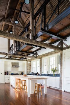 The Sagans added an airy, barn-like extension to the house, complete with an elevated walkway modeled after an old railroad bridge nearby.