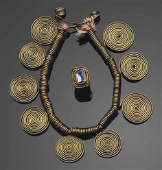 Necklace & Ring |  Alexander Calder.  ca. 1939. Necklace; brass wire and string.  Ring; Brass wire with glazed ceramic fragment.