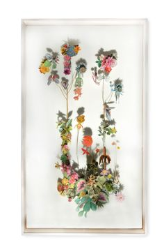 "Beautiful collage of paper flowers mixed with real pressed flowers, mounted on pins behind glass. These ""gardens for the wall"" have amazing detail - a piece of art to keep through all room stages. Artist: Anne Ten Donkelaar"
