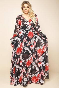 A plus size maxi dress with a wrapped V-neckline and long sleeves. Features a belted waistline. Floral print on sheer mesh all over.
