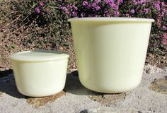 """True original vintage Mckee custard glass, ( ivory). The Mckee custard can have variations in the coloring. This is more yellow than ivory, but is not the Seville Yellow. The small canister measures about 4 1/4"""" x 2 3/4"""", and the larger is abou..."""