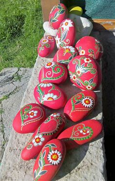 Painted beach stones. Reminds me of a Swedish floral print.