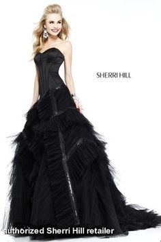 Sherri Hill Dress 9501 Pageant Gown. This unique ball gown has an edgy style! The satin bustier bodice has seams along the boning. The full skirt has angled layers of pleated tulle with beaded trim. Mid zip back. Finishes with a dramatic train. Stand out from the crowd in this gown!