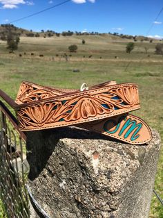 Turquoise underlay floral belt made by DustyCowgirl Leather  Like us on Facebook