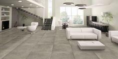 Stoere grote tegels in woonkamer met de uitstraling van beton