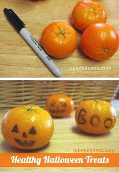 Mandarins with pumpkin faces