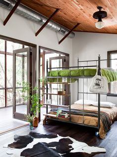 custom metal rolling queen bunk beds / Richard Linklater's Austin area Bunkhouse in Tribeza