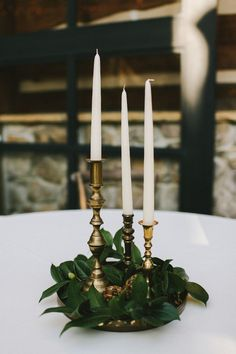 greenery, plain candles, brass