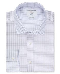 Closely tailored through the chest, body and arms, our fitted shirts offer a neat, contemporary fit. The easy-iron finish makes this a great choice for a weekday shirt.