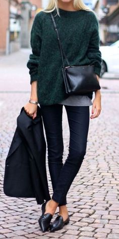 Cozy evergreen fall sweater paired with dark denim and loafers.
