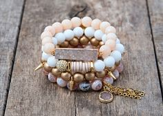 "The Paige Set is a combination of 4 handmade beaded bracelets to include a variety of gemstones and metal accents. Each elastic bracelet is 7""."