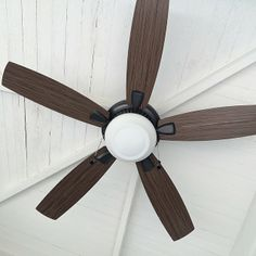 painted outdoor porch ceiling + contrasting wooden fan