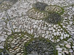 patterns in paving of river rocks and field stones in the Chinese Garden in Portland, Oregon