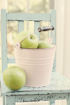 love the color of the chair with the pale apples