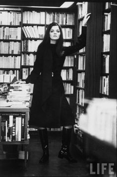 Linda Morand wearing a leather midi skirt by Daniel Hechter.  Photo: Pierre Broulet for LIFE Magazine 1968 Shot at Shakespere's Bookstore Paris