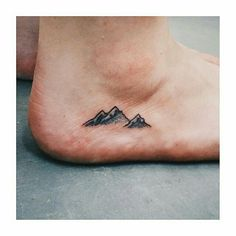 Mountain tattoo Means KEEP ON CLIMBING UP