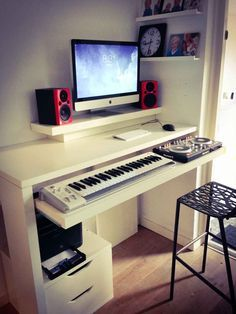 Standing work desk and DJ booth - IKEA Hackers;  hacked the keyboard tray with drawer rails.