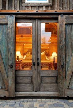 Ana Rosa / cabin retreat / log homes / different perspective. LOVE the doors & barn door protector. Door Design, House Design, Window Design, The Doors, Sliding Doors, Wood Doors, Entry Doors, Exterior Doors, Patio Doors
