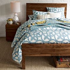 The old wood really loves the light blue/white color scheme. Someone want to make me a King size version of this bed?