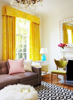 yellow curtains, black and white rug, chandelier and sheep skin...beauty.