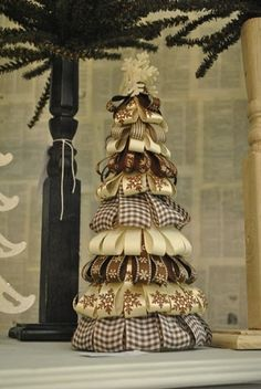 Christmas Ribbon tree with styrofoam. This would be super cute in bright colors for the kids room. ;)