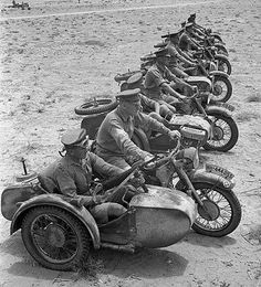 1941 North Africa: British troops in captured German BMW motorcycle sidecar combinations.
