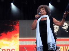 """On Oct. activist, educator and Black liberator Angela Davis encourages young people to vote at the """"Many Rivers to Cross Festival"""" in Atlanta, Georgia. Angela Davis, Oct 1, Interesting Stories, Atlanta Georgia, News Stories, Young People, Rivers, Revolution, Kimono Top"""