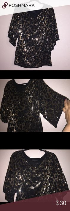 💖REDUCED💝Like New sparkly gold shirt Loose fit gold sequel dress up shirt used ones.. Belldini Tops Blouses