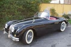 Jaguar XK150 Roadster - yes, that was one of them, in silver with blue leather. I miss it!