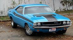 1970 Dodge Challenger T/A:  stock with a 340 Six-Pack, Trans-Am racing stripes, vinyl hood decal, and Rallye wheels.  Gorgeous!!