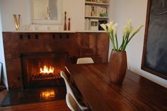 Copper fireplace surround.